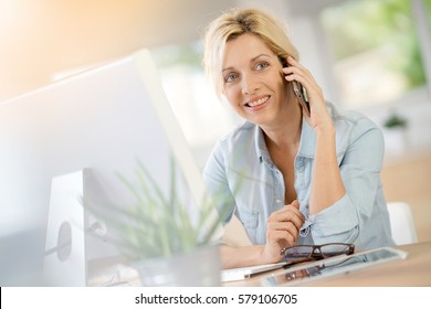 Businesswoman in office working on desktop computer
