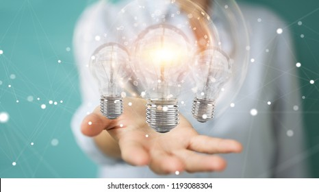 Businesswoman on blurred background connecting modern lightbulbs with connections 3D rendering