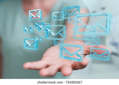 Businesswoman on blurred background holding and touching floating emails 3D rendering