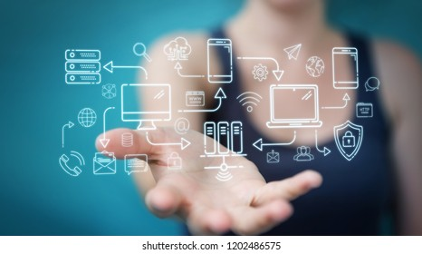Businesswoman on blurred background using tech devices and icons thin line interface