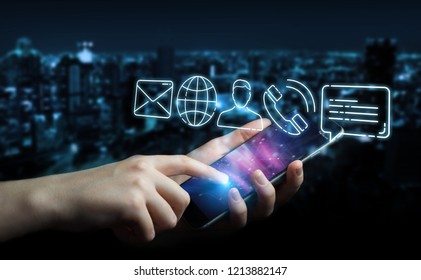 Businesswoman on blurred background using thin line contact icon with mobile phone