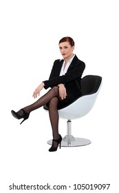 A businesswoman on a chair.