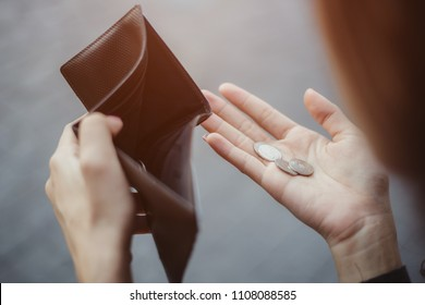 businesswoman on have money unemployed and bankrupt looks into his empty wallet. Stress crisis, unemployed businessmen are waiting for new jobs, recession situation and hopelessness crisis concept.