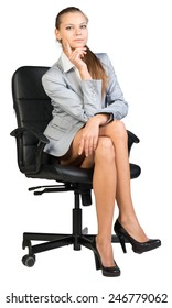 Businesswoman on office chair, looking at camera, with her legs crossed and her hand propping her cheek. Isolated over white background