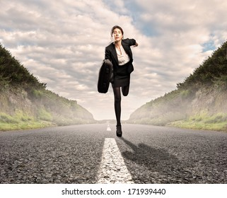 businesswoman on a road running. Motivation concept.