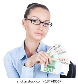 Businesswoman on workplace with euros in hand