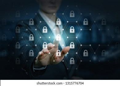 A businesswoman is operating with data and finance protection system consisting of network connection combs with padlocks inside at the blurred background. The concept of data and finance protection.