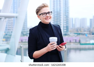Businesswoman in Phone Call and Holding Reusable Coffee Cup