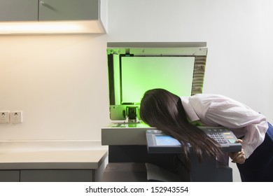 Businesswoman Photocopying Her Face