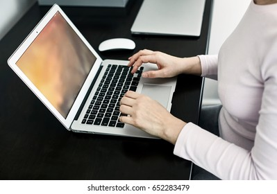 businesswoman pointing at her laptop