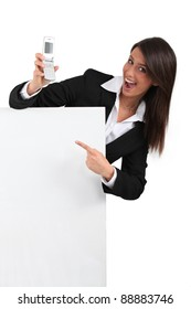 Businesswoman pointing at mobile phone