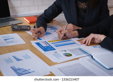 Businesswoman pointing pen on business document at meeting room.Discussion and analysis data charts and graphs showing the results at meeting.
