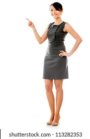 Businesswoman pointing something - isolated over a white background