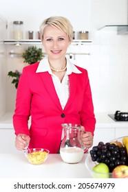 businesswoman preparing breakfast before work