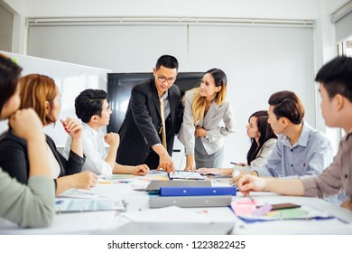 Businesswoman presenting to colleagues at a meeting.Successful team leader and business owner leading informal in-house business meeting.Business and entrepreneurship concept.