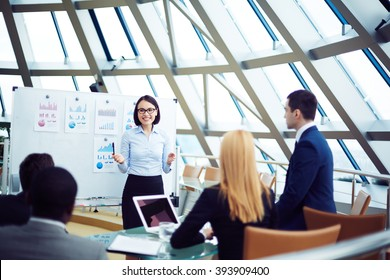 Businesswoman presenting her ideas to business partners