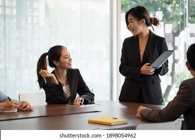 Businesswoman presenting new project to partners, Business Meeting Concept