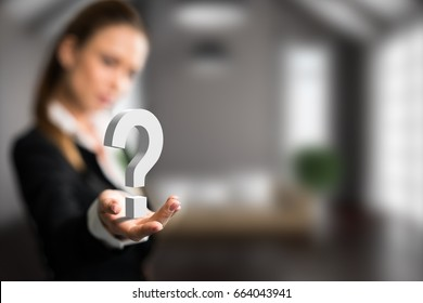 businesswoman presenting a questionmark in front of an apartment scene