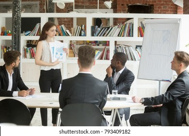 Businesswoman presenting startup design project to investors, manager designer shows clients statistics report and color swatches palette, giving presentation of work result at executive team meeting