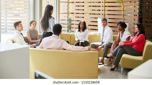 Businesswoman presenting at a team meeting in lounge area