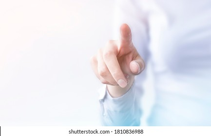 businesswoman presses on transparent touch screen. new technology