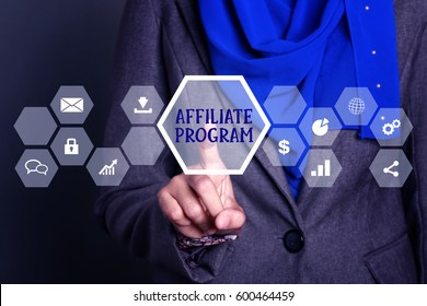 Businesswoman pressing button on virtual screen wtih word Affiliate program