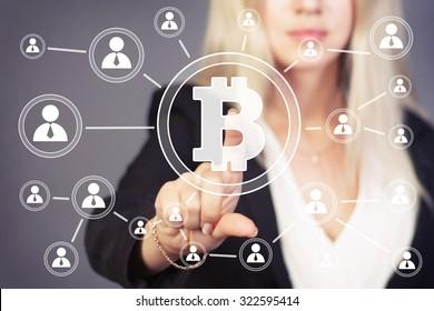 Businesswoman pressing button web bitcoin icon