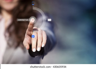 Businesswoman pressing contact us button on virtual touch screen. Customer service concept.