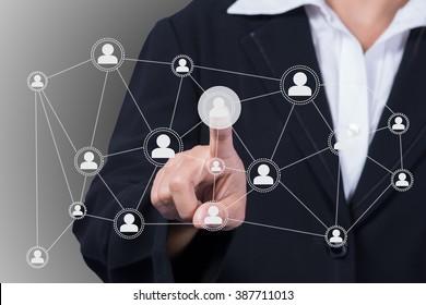 Businesswoman pressing network icon.