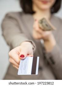 Businesswoman proposing plastic card, closeup shot