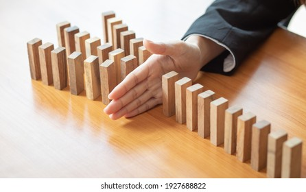Businesswoman protect wooden block fall to planning and strategy in risk to business Alternative and prevent. Investment Insurance ,Business risk control concept,