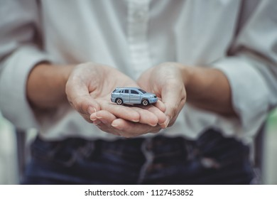 Businesswoman with protective gesture and car. solution for the best protection.Car insurance and collision damage waiver concepts.