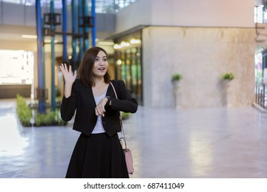 Businesswoman raises hand