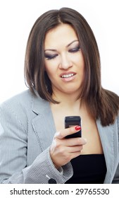 Businesswoman reading boring SMS on her cell phone