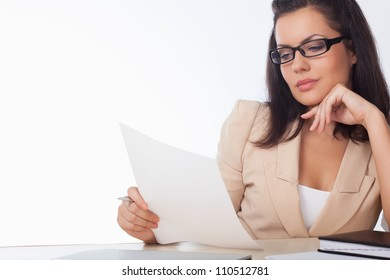 businesswoman reading document over white background
