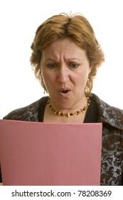 Businesswoman reading her layoff notice