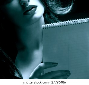 Businesswoman reading her notes