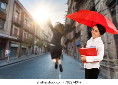Businesswoman with red umbrella