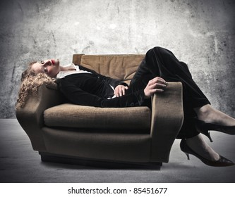 Businesswoman relaxing on an armchair