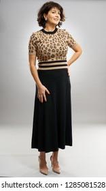 Businesswoman in retro dress, full length on gray background
