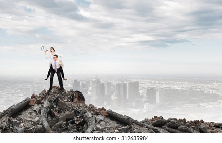 Businesswoman riding on back of her colleague