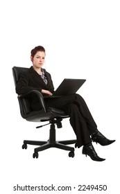 Businesswoman sat on an office chair using a laptop computer