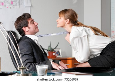 businesswoman is seducing her boss at office