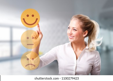 businesswoman is selecting a happy emoticon