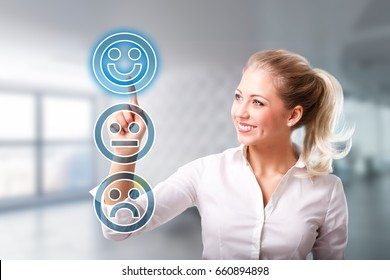 businesswoman is selecting a sad mood smiley