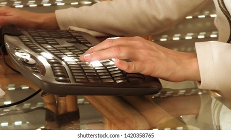 Businesswoman shopping online in e-commerce. The concept of online payment, compulsive shopping, shopping addiction. Woman hands typing on black computer keyboard.