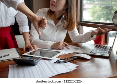 Businesswoman show dislike,unlike,thumbs down hands in meeting. ,Unsuccessful business woman.