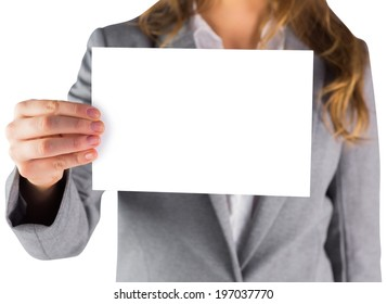 Businesswoman showing a blank card on white background