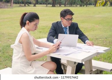 Businesswoman showing boredom to talk to a business man, business concept