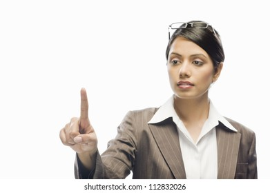 Businesswoman showing her index finger against a white background